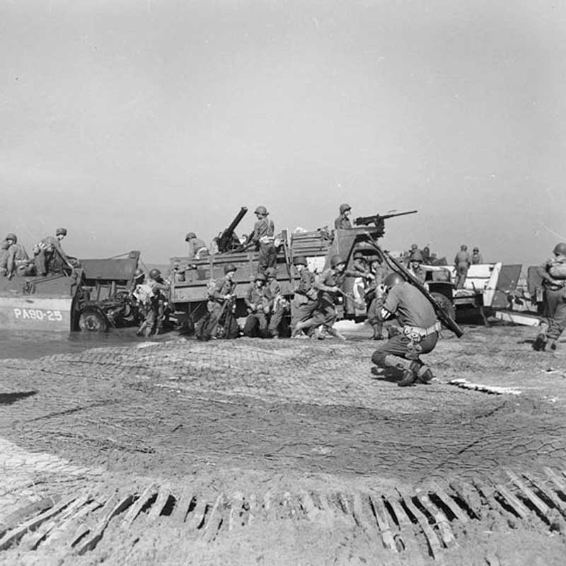 Artillery being landed during the invasion at Salerno
